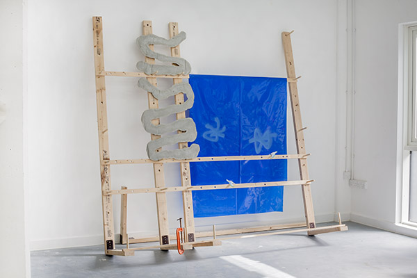 Glassrack Blue With Climbing Plant